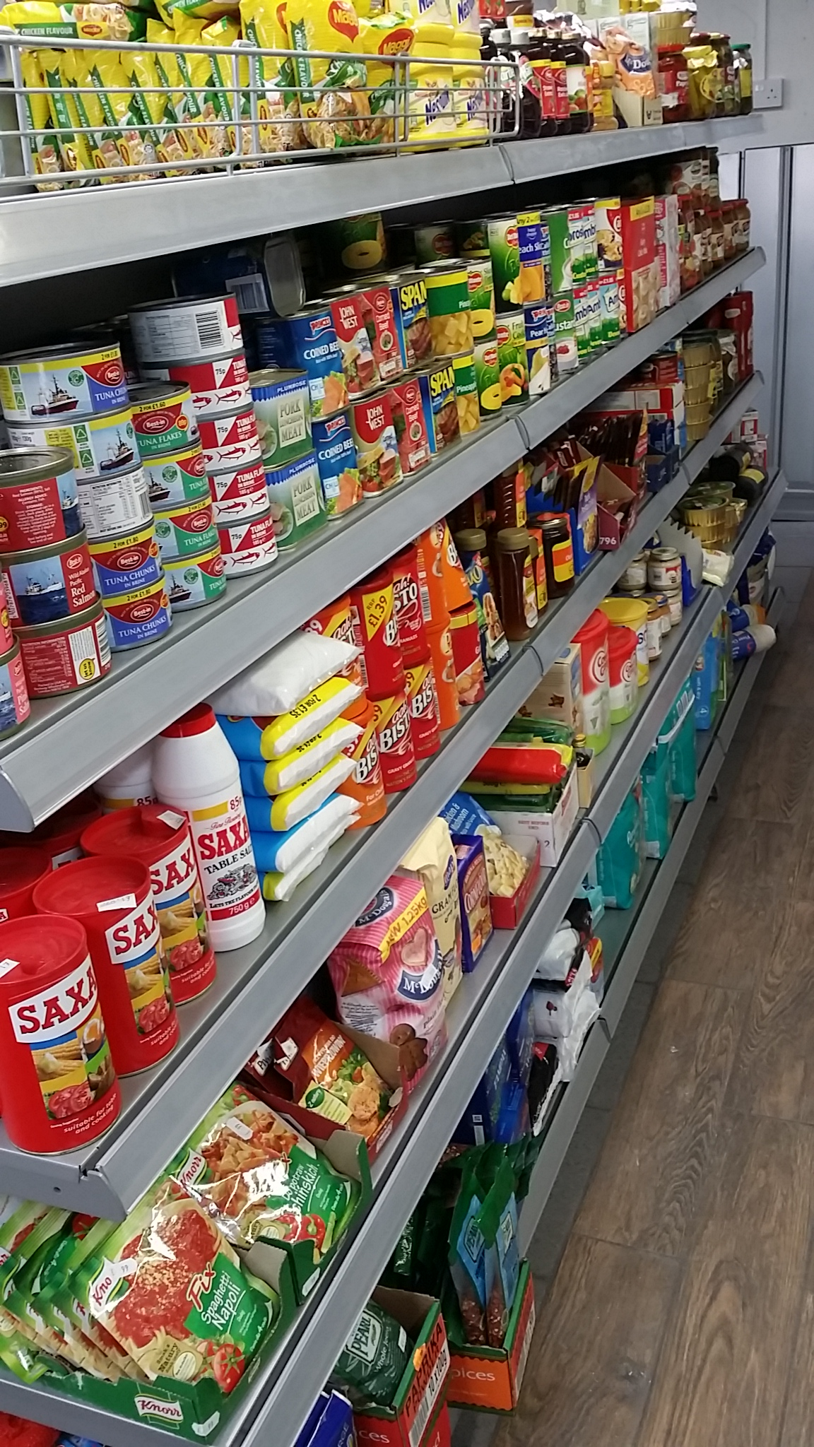 Silver Wall Shelving in Convenience Store
