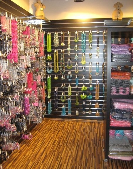 Slatwall hooks and accessories in use in a retail store