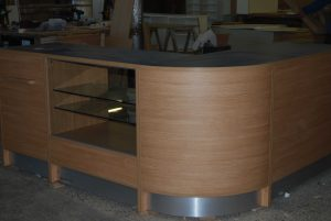 Curved-Reception-Desk-With-Display-Cabinet