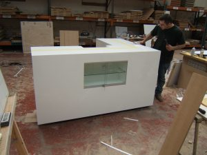 L Shaped Counter With Built In Glass Display Cabinet.