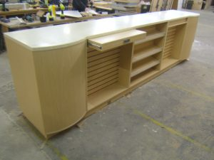 Bespoke Shop Counter with Slatwall Displays and Confectionery Shelves.